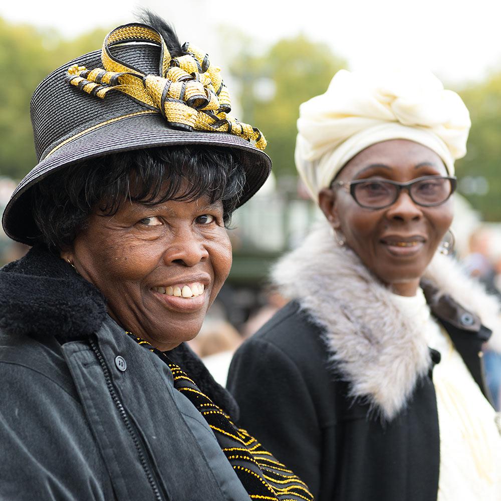 Women outside Buckingham Palace, London